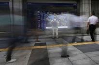 Asia stocks dip, lower yields keep dollar in check