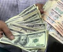 Rupee down 40 paise against dollar in early trade