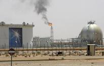 Saudi cuts official crude prices in battle for market share