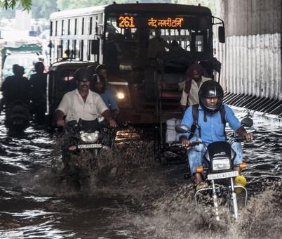 PHOTOS: Heavy rains, traffic halt Delhi