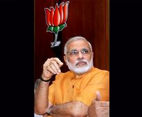 Modi meets upset Advani takes charge of new job