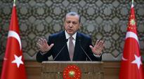 Turkey vows to shoot down any new intruder, Russia responds with economic sanctions