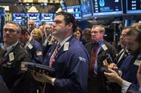 Stocks gain on central bank stimulus signals, mergers