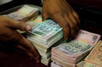 Rupee trades higher at 60.63 per dollar