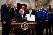 Trump wants to send man back to moon, Mars