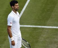 Wimbledon 2016: Rain saves Djokovic from stunning upset as Federer and Serena advance in contrasting fashion