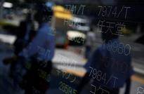 Asia shares track Wall St. higher, U.S. dollar firm