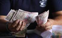 Rupee advances by 46 paise against dollar