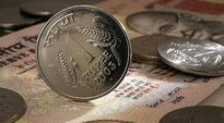 Candidate hands over Rs 8500 in Re one coins as security deposit