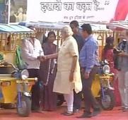 PM Modi takes a ride on e-rickshaw in Varanasi