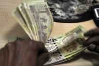 Rupee closes 9 paise weaker at 61.45 per dollar