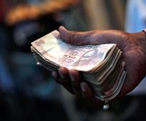 Rupee falls on dollar's gains against currencies overseas