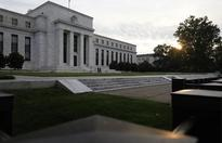 Fed seeks more capital from big banks, relief for regional lenders