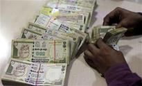 Indian rupee falls below 55 level against US dollar, down by 12 paise