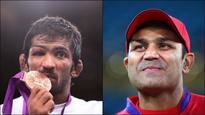 Laughter alert! Sehwag's reaction to Yogeshwar's medal upgrade will leave you in splits