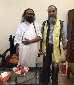 Away from chaotic Kashmir, Burhan Wani's father spends time at Sri Sri's ashram