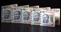 Rupee falls to one-month low on high dollar demand