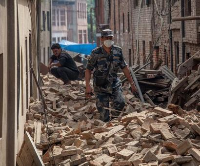 In Nepal, rescue teams race against time to help people