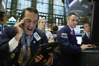 Wall St falls as data adds to growth worries; biotechs down
