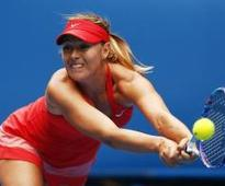 Sharapova schools Bouchard to advance in Melbourne