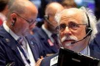 Pfizer, banks lead Wall Street lower; presidential debate eyed
