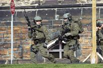 Ottawa in lockdown after Canadian parliament attacker killed soldier shot at dies