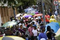 Huge crowds gather for last view of Mandela