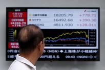 Asia shares firm as traders add to ECB stimulus bets