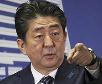 Japan's Abe wins votes but not hearts: Analysts