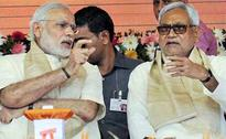 Its mixed bag for NDA, GA in pre-poll surveys; Face-off gets hotter between Modi, Nitish