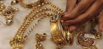 Gold Holds Gains on Geopolitical Tensions But US Rate View Drags