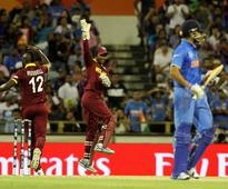 Dhoni leads from the front as India survive West Indies scare, win by 4 wickets