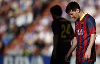 Barca title bid hit by shock loss in Valladolid