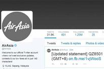 AirAsia mourns for flight QZ8501 with grey logo after jet goes missing with 162 people on board