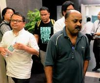 Malaysia police arrest three editors on sedition charges