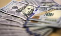 Dollar rises while oil falls, world stocks mixed