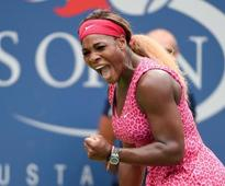 Defending champ Serena Williams reaches quarter-finals