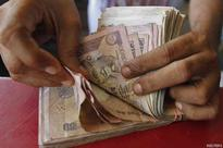 Rupee gains on foreign flows, but falls for the week