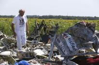 Ukraine says suspends attacks to let experts reach crash site, rebels deny