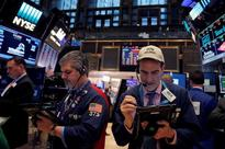 Strong earnings boost S&P, Dow; Alphabet drags Nasdaq