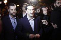 Greek PM Tsipras freezes privatisations, markets tumble