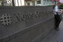 News Corp to take charge of up to $1.4 billion this quarter