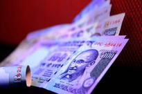 Rupee trades higher at 66.42 against US dollar