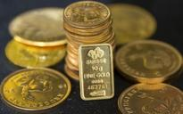 PRECIOUS-Gold surges to 1-year high on financial uncertainty