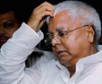 I am busy fighting communal forces: Lalu