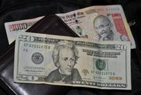 Rupee ends 20 paise weaker at 61.24