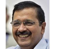 Kejriwal faces slogans, black flags after releasing trade manifesto