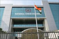 Nifty falls, retreats from record high