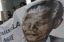 China pays homage to Mandela, calls him an 'old friend'