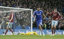 Title rivals Chelsea, Man City pass West test